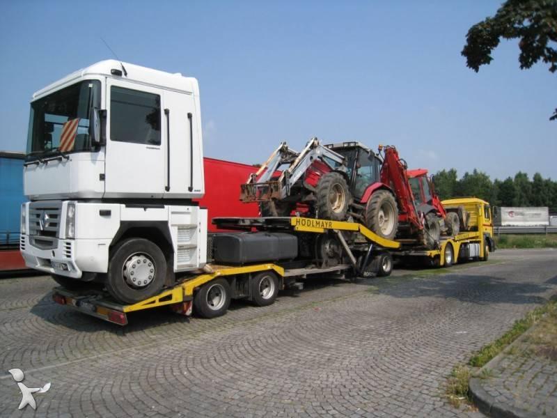 460889-ciężarowka_z_przyczepą-man-do_transportu_samochodow.jpg